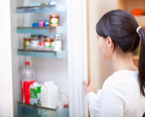 Woman looking inside the fridge